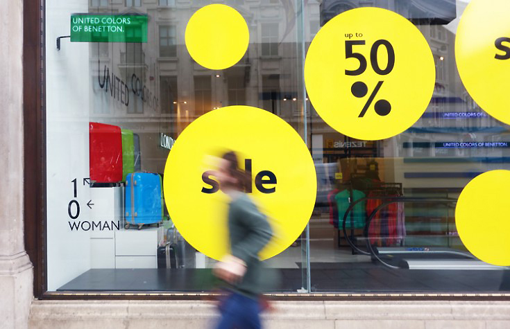 large format round yellow 50% sale graphics on a window