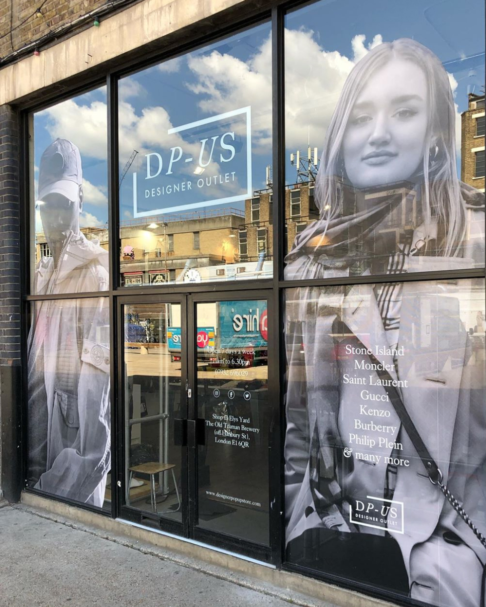 window graphics in a boutique shop showing a man and a woman