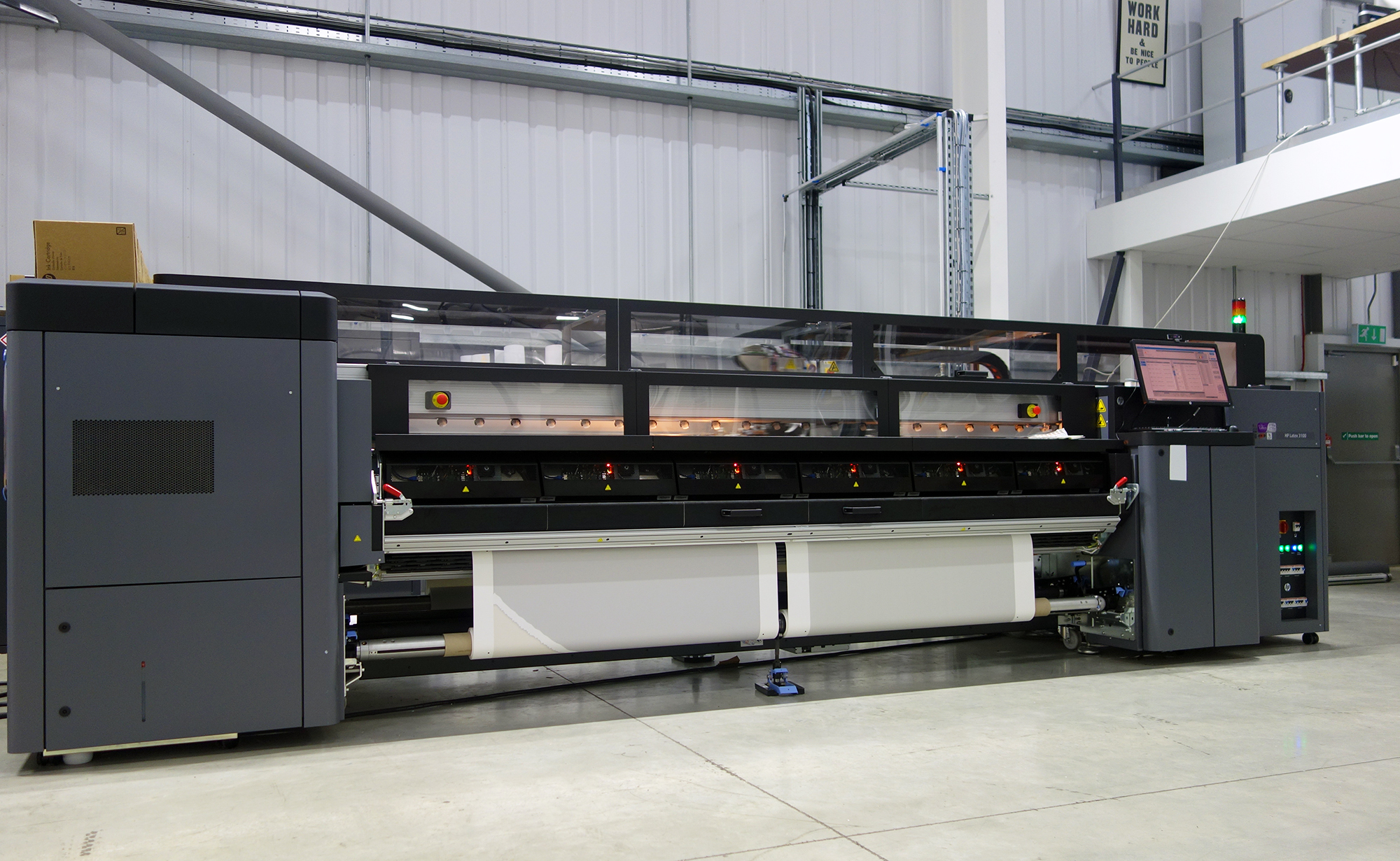 large format printer in a print shop